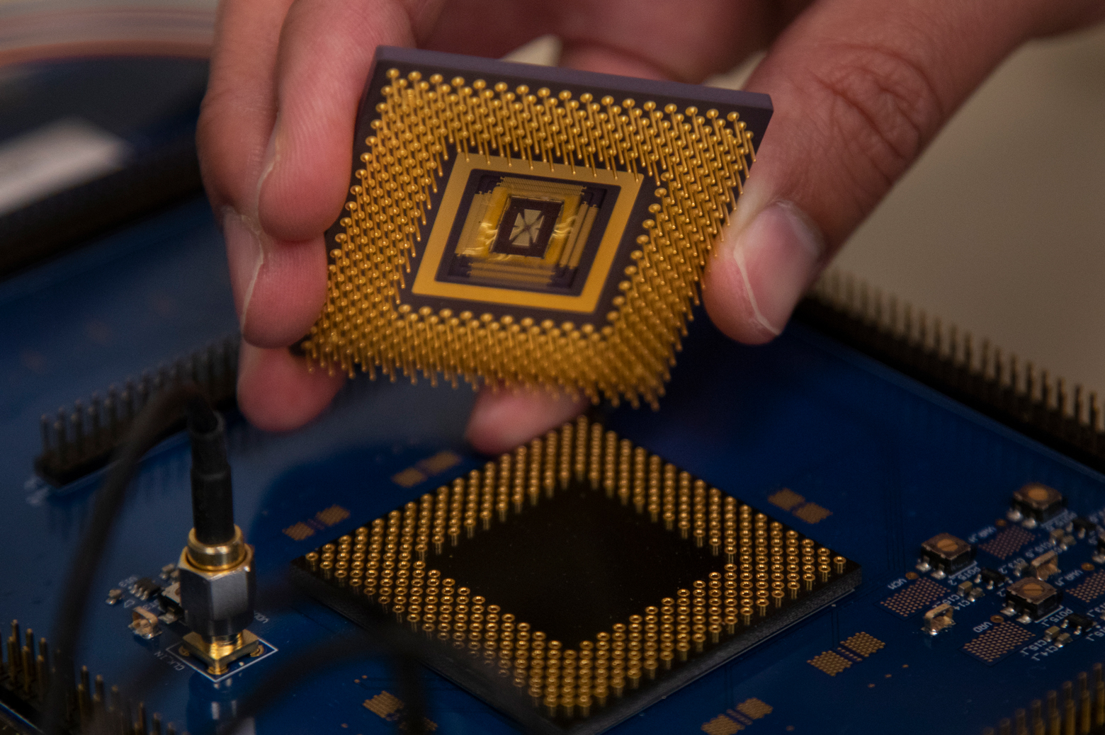 The memristor array chip plugs into the custom computer chip, forming the first programmable memristor computer. The team demonstrated that it could run three standard types of machine learning algorithms. Photo: Robert Coelius, Michigan Engineering Communications & Marketing