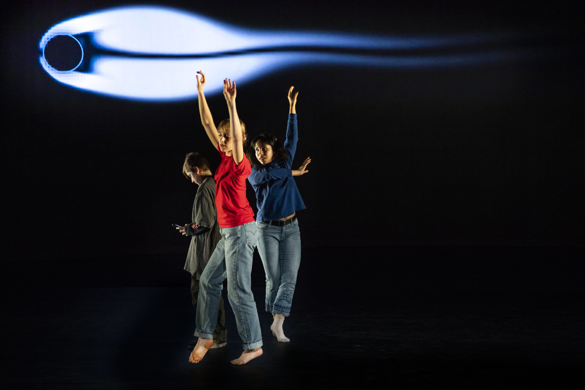 A photograph of dancers performing physics principles.