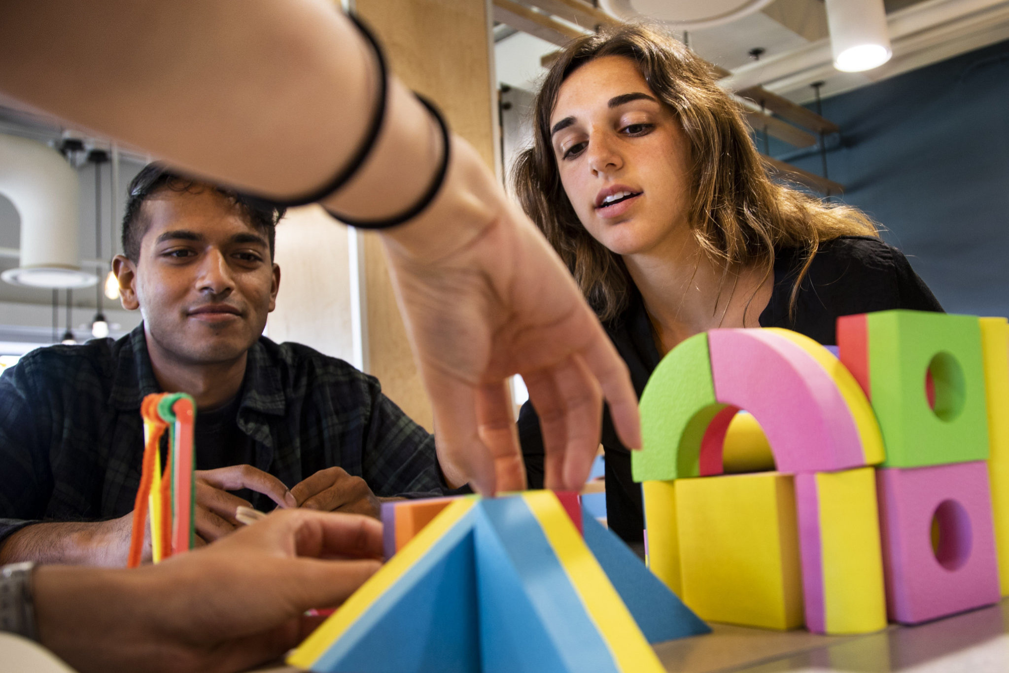 Members of the the Center for Socially Engaged Design (C-SED) work with building blocks