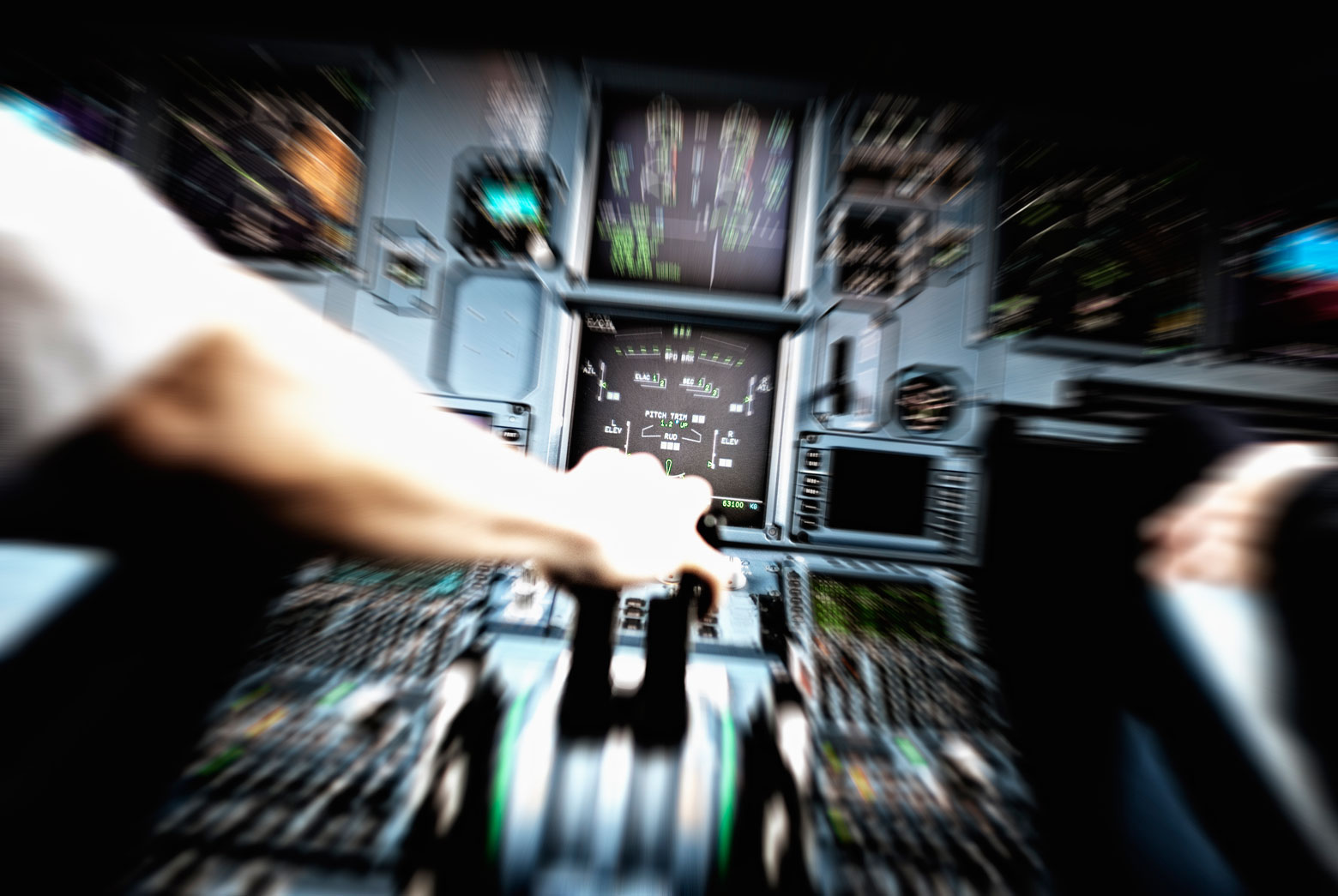 Airplane pilot's arm grips the lever on the control pad