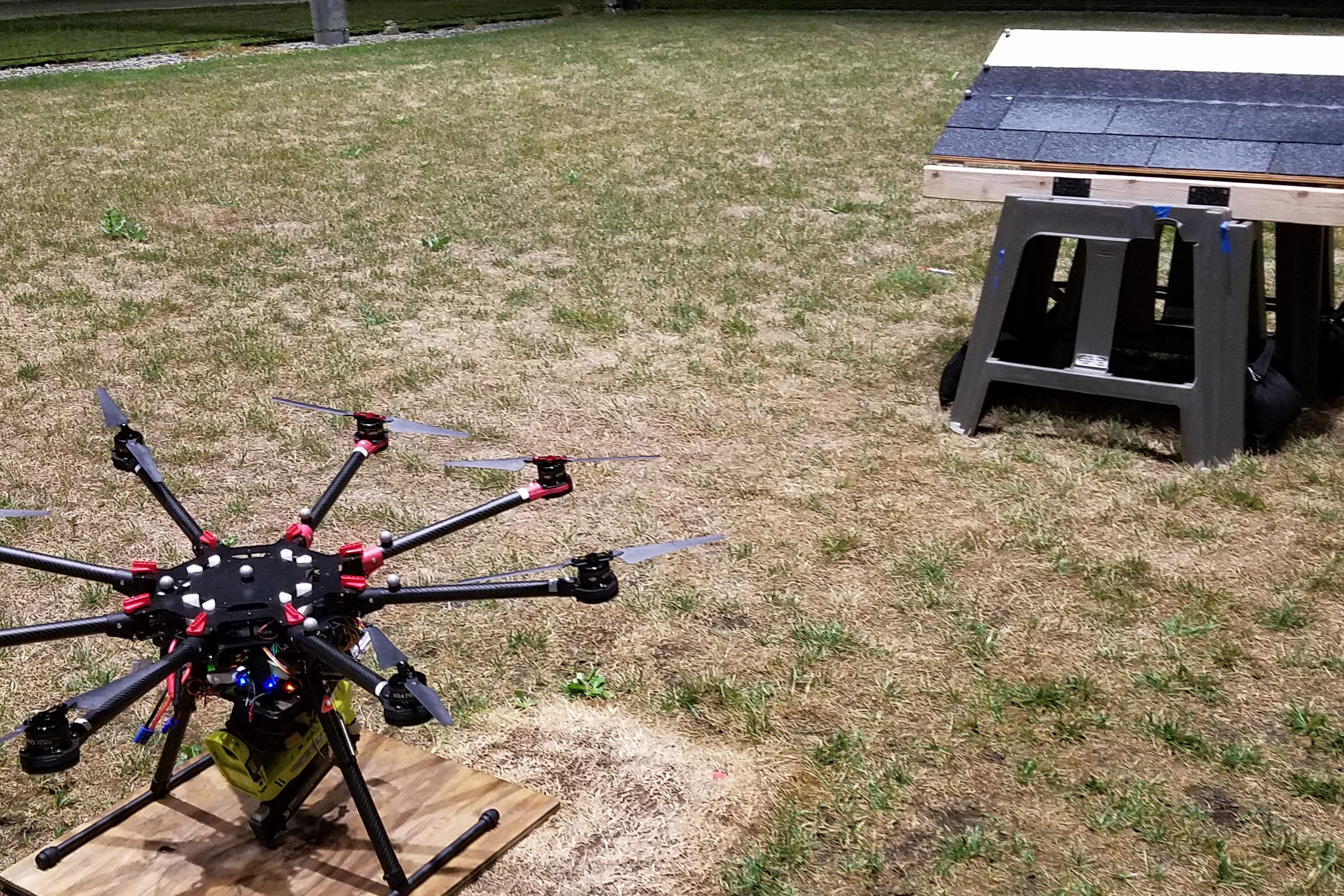 A nail gun attached to an octocopter. Credit: Matthew Romano, Michigan Robotics, University of Michigan.