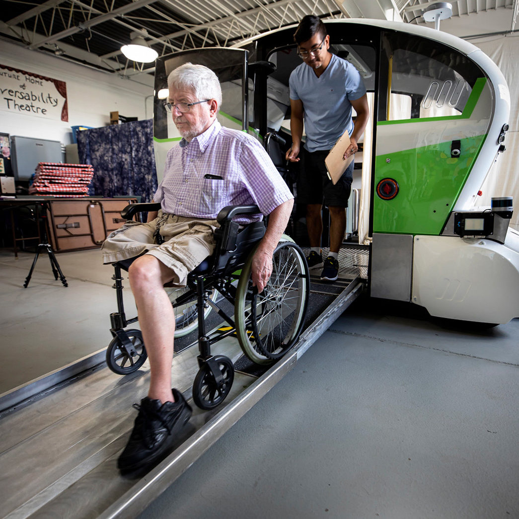 Duke Morrow uses a ramp to exit the vehicle in his wheelchair