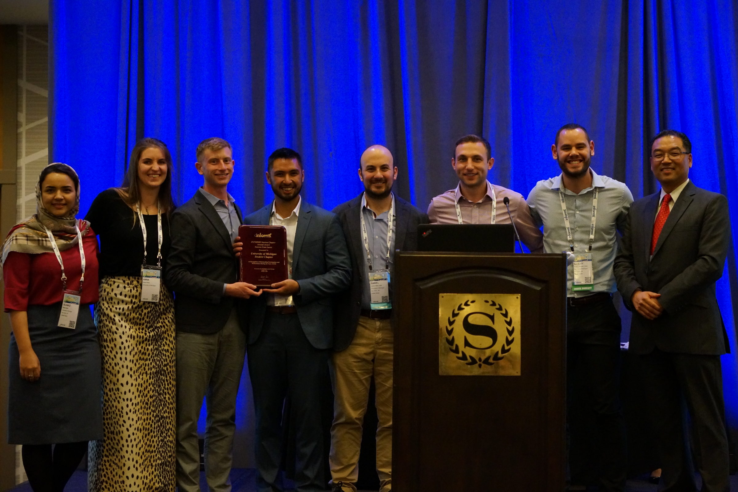 INFORMS Student Chapter at U-M members accept their award on stage at the INFORMS Annual Meeting in Seattle.