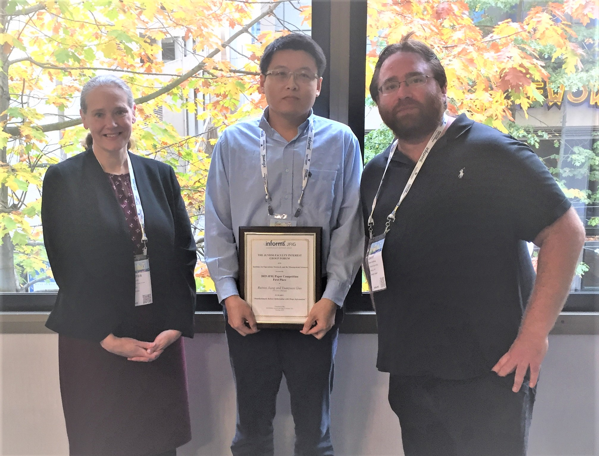 Ruiwei Jiang receives JFIG award at the INFORMS Annual Meeting in Seattle.
