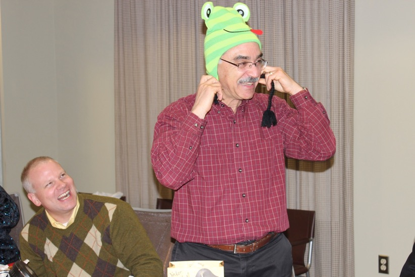 Prof. Neuhoff wears a funny frog hat and laughs