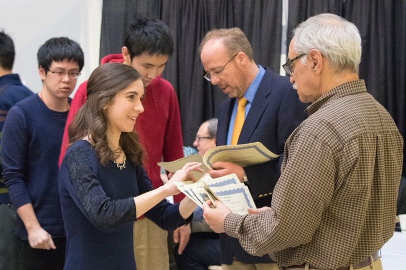 Prof. Neuhoff hands out awards to students