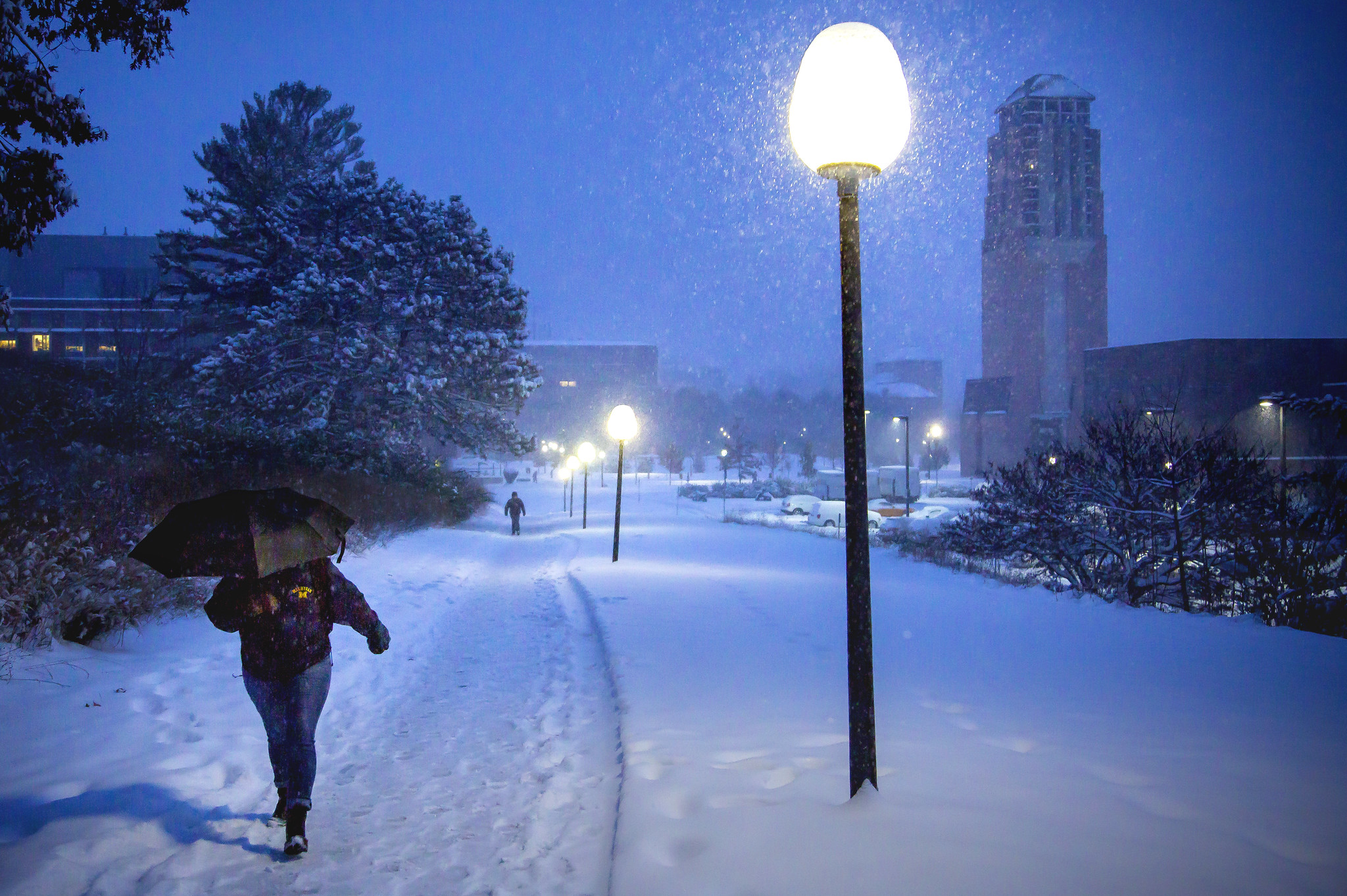 A student walks through a snow storm on North Campus.