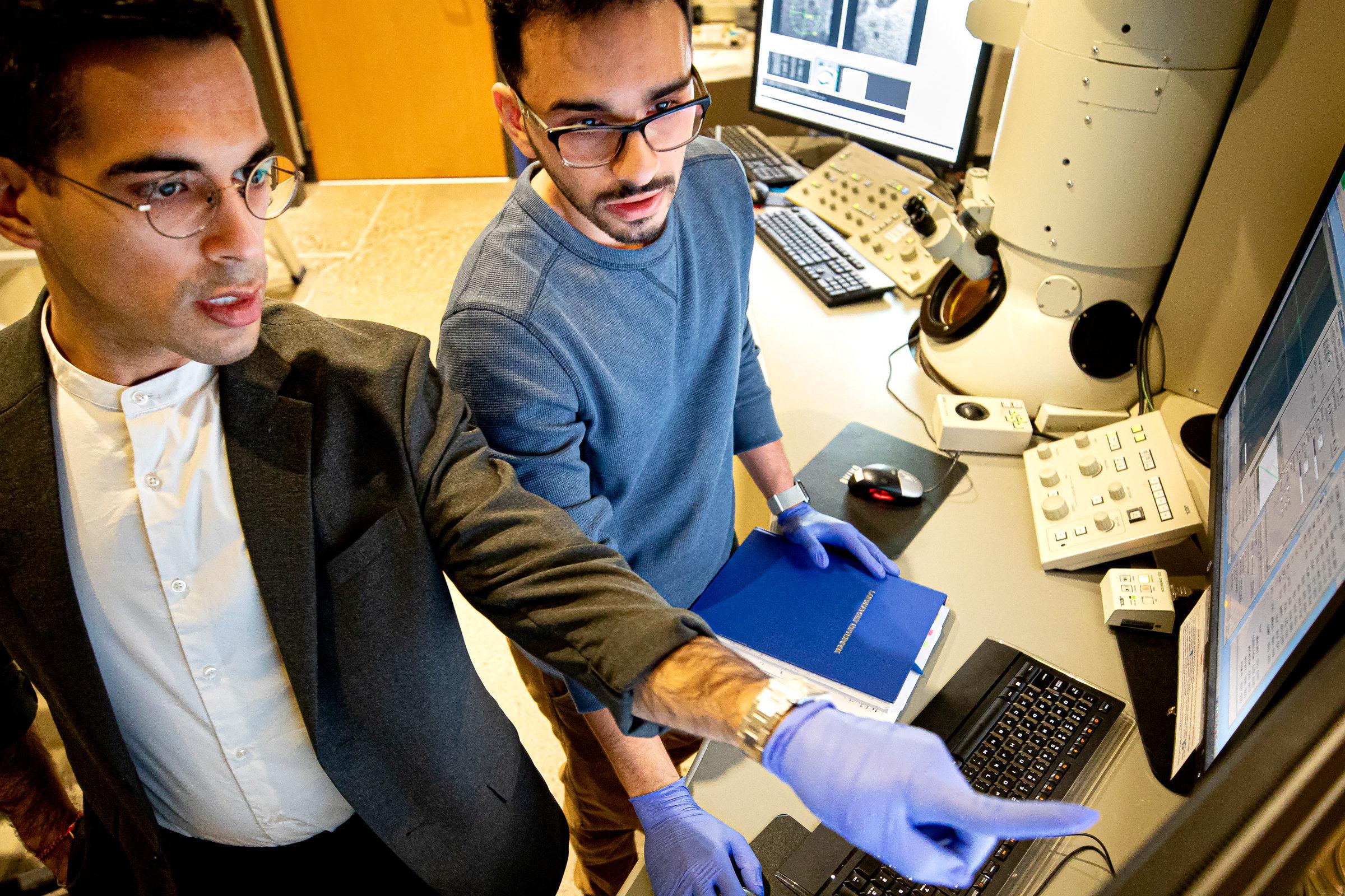 Ashwin Shahani and Saman Moniri work in the lab