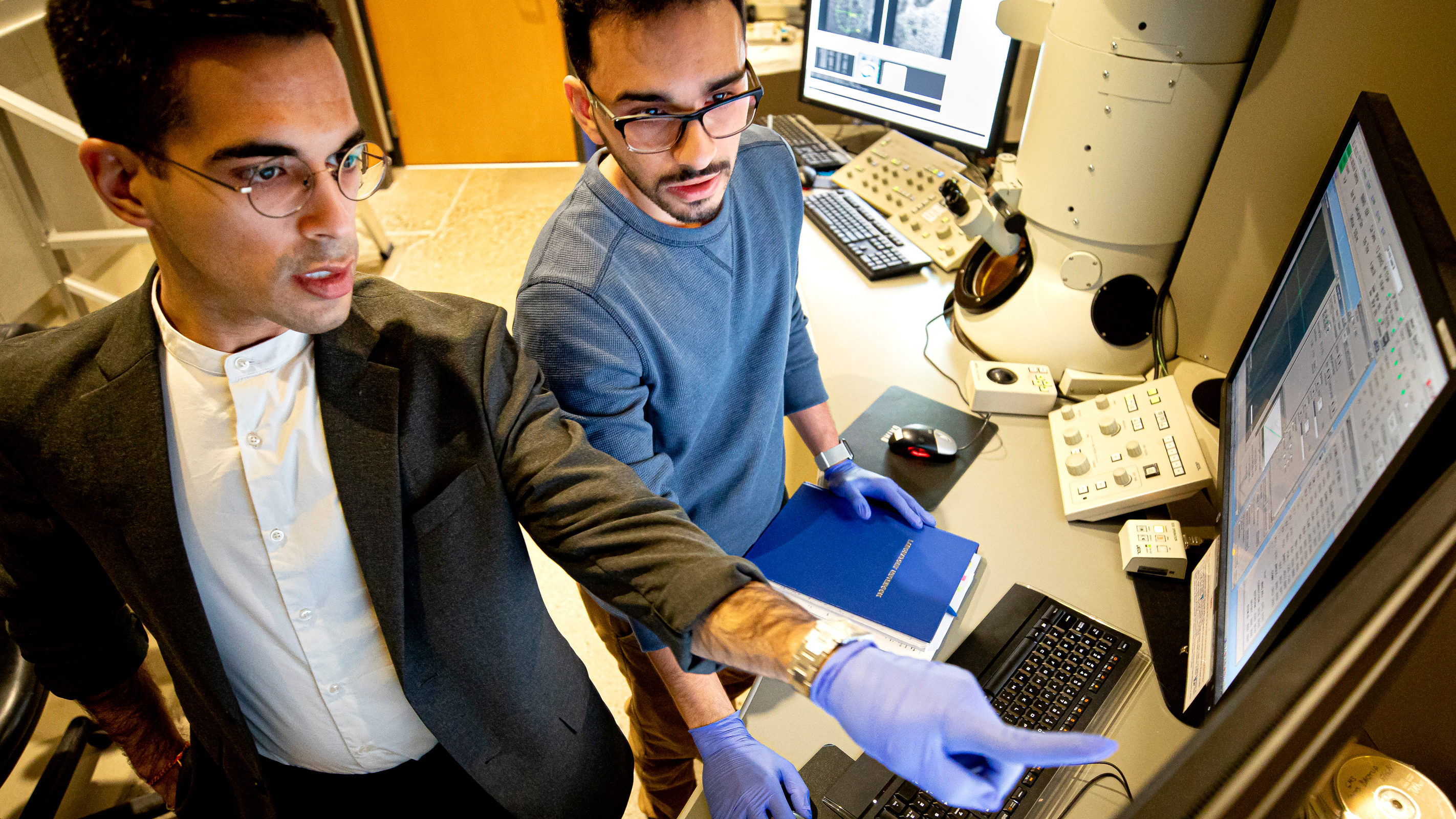 Ashwin Shahani and Saman Moniri work in the lab