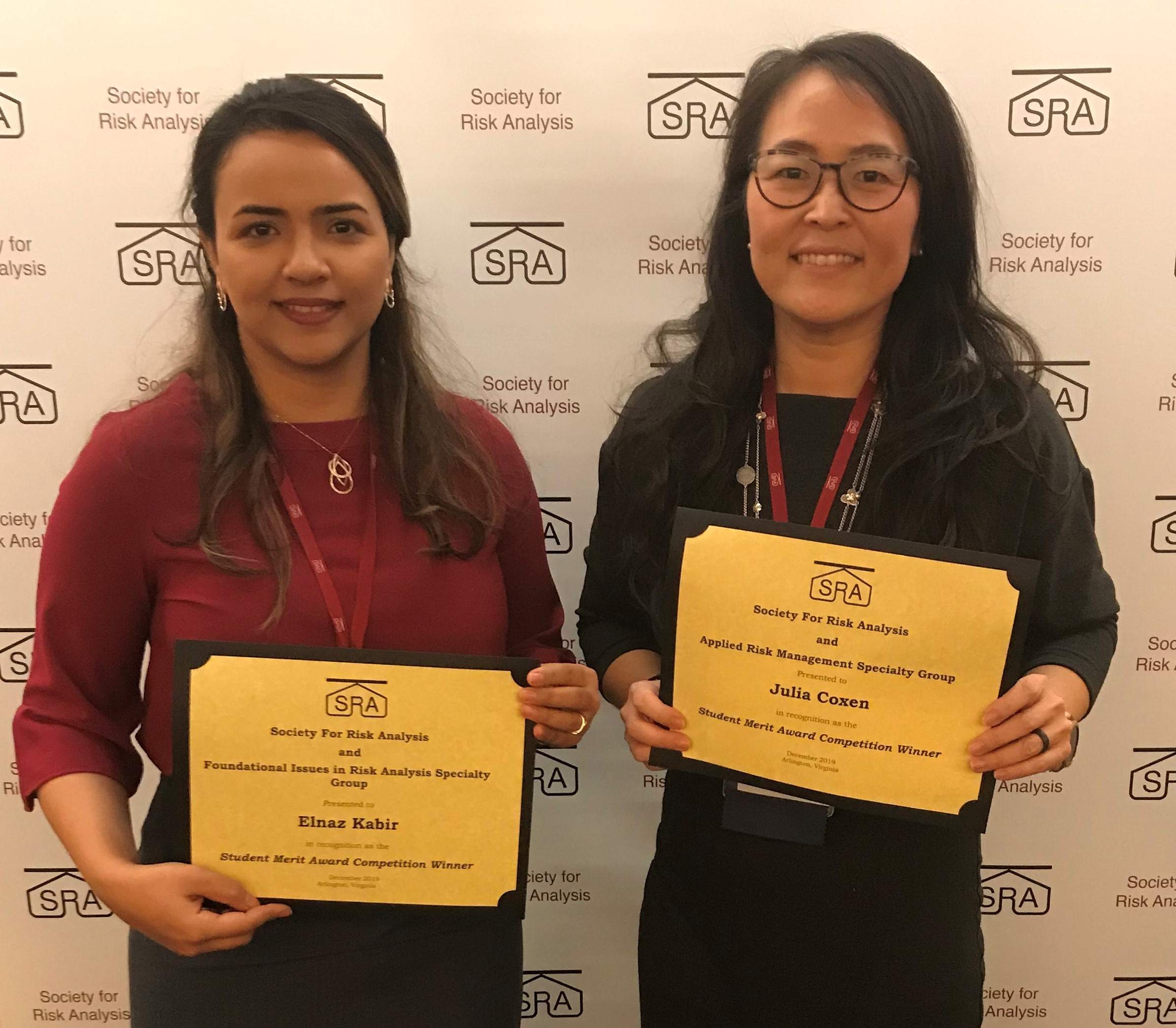 Photo of Elnaz Kabir and Julia Coxen holding their award certificates.