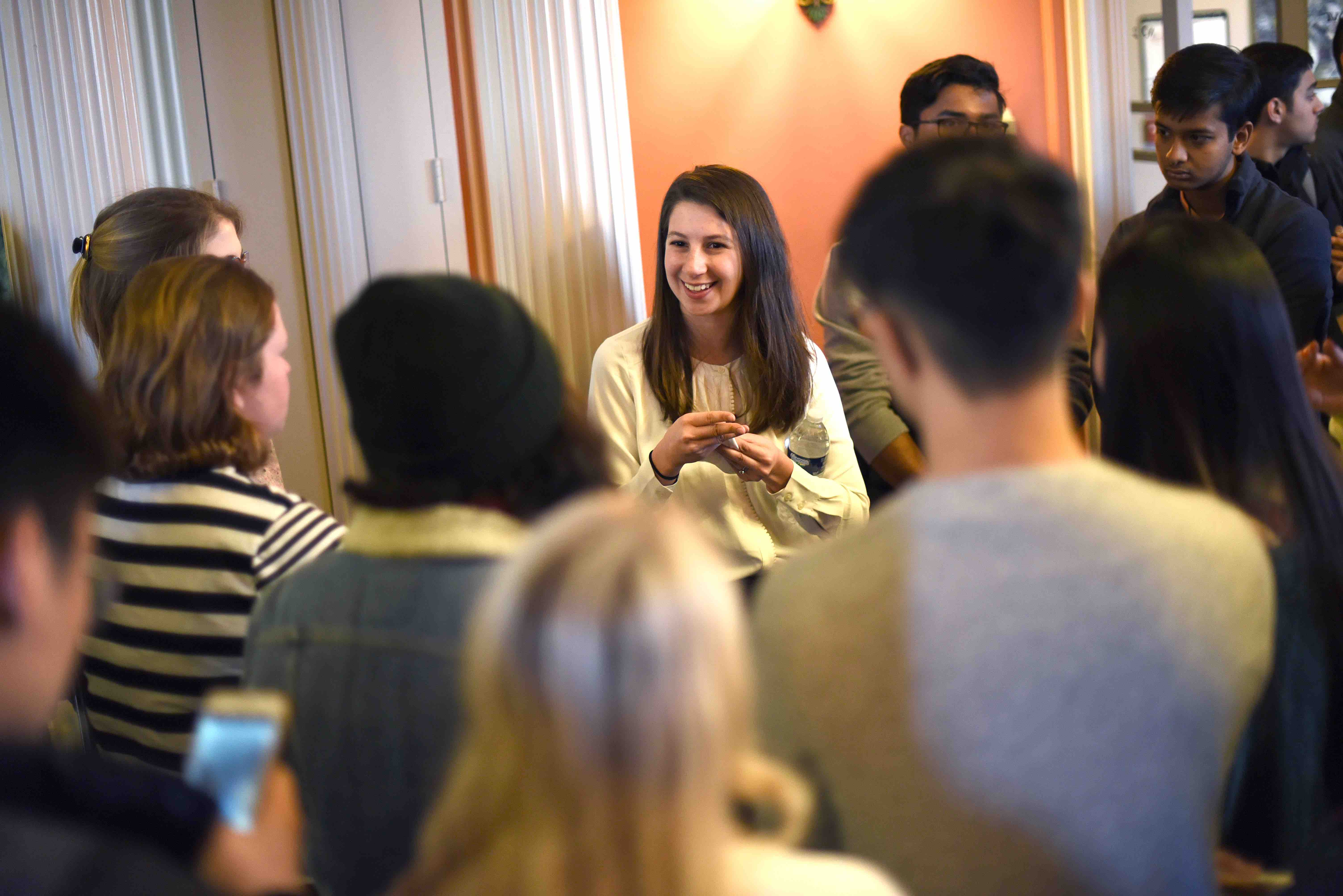 Dr. Katie Bouman chats with a crowd of students