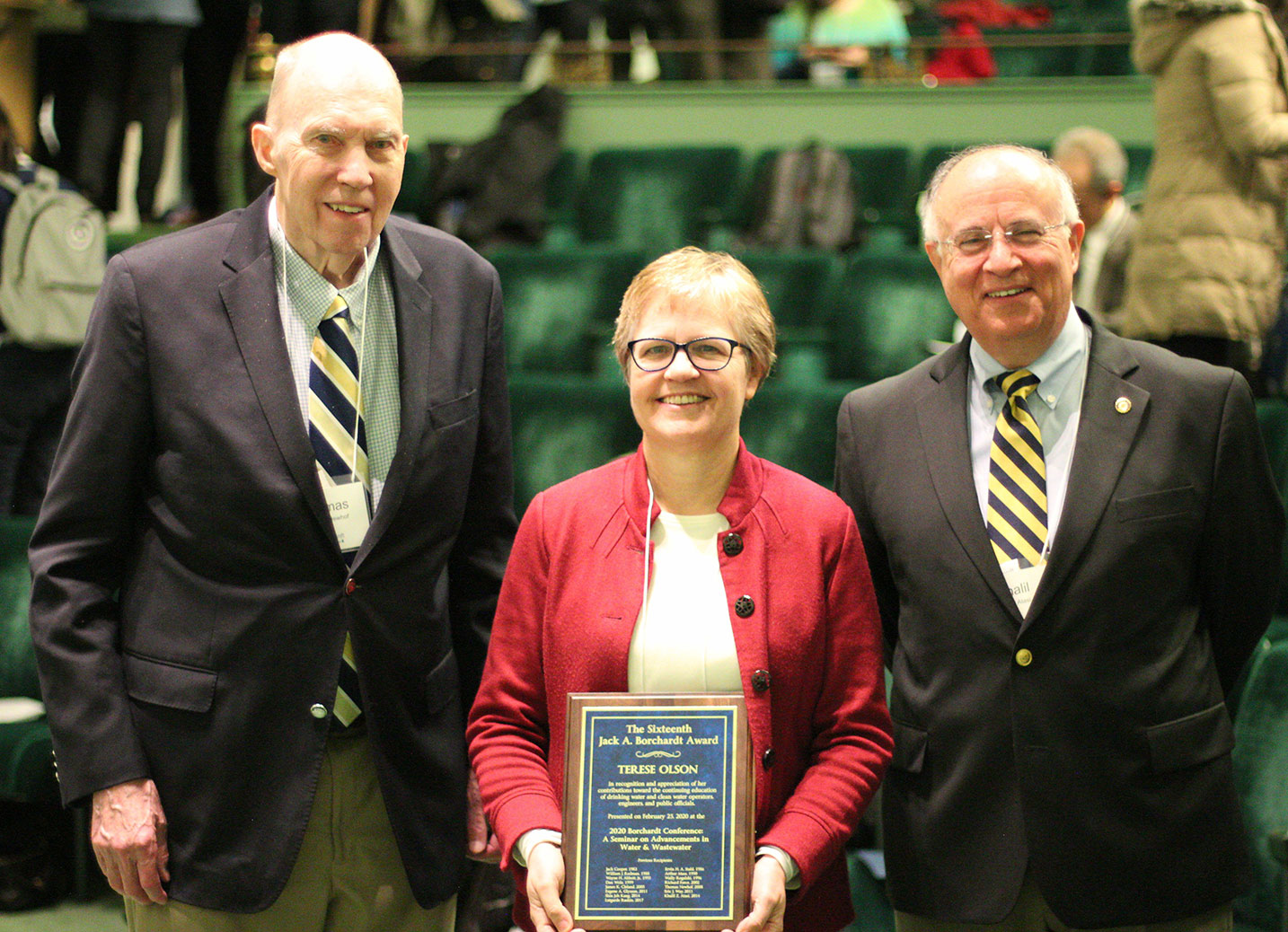 Terese Olson holds the Borchardt award plaque