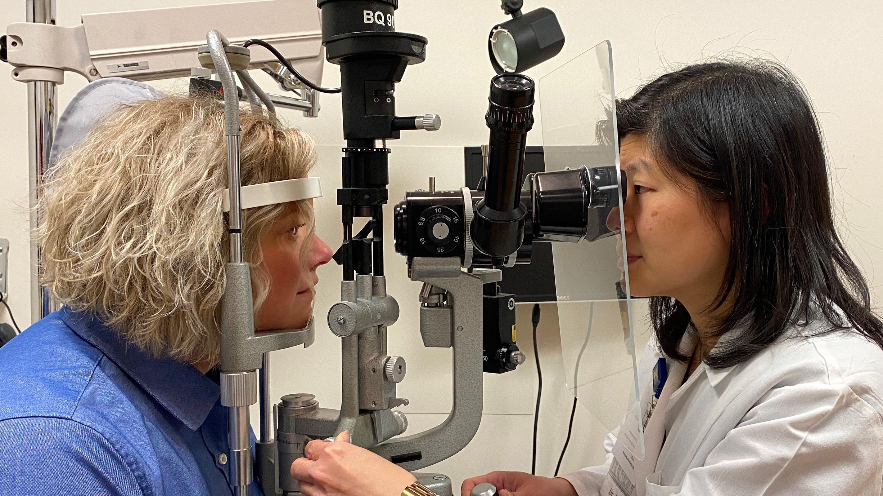 a doctor giving an eye exam