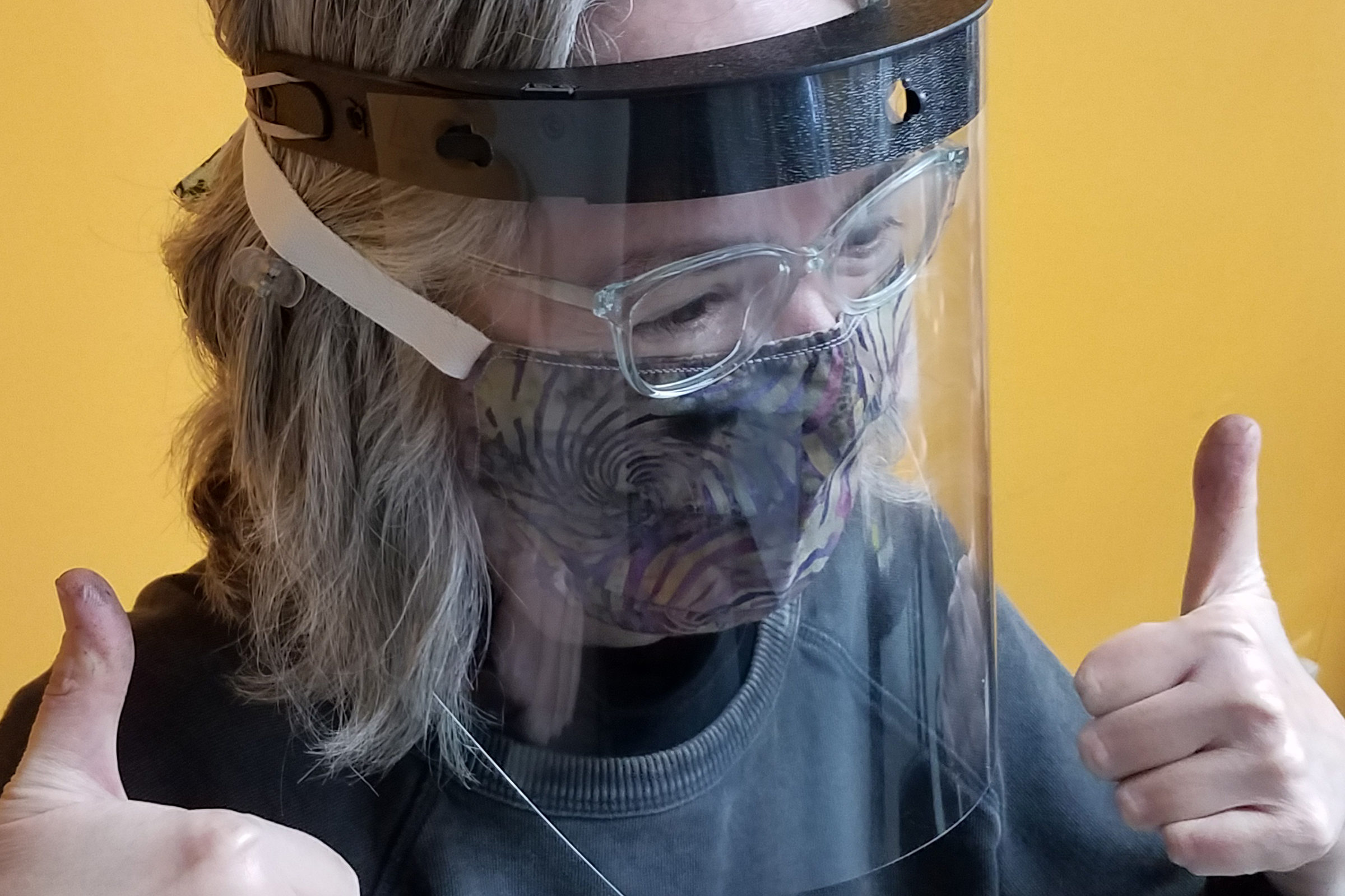 a woman wearing a face shield