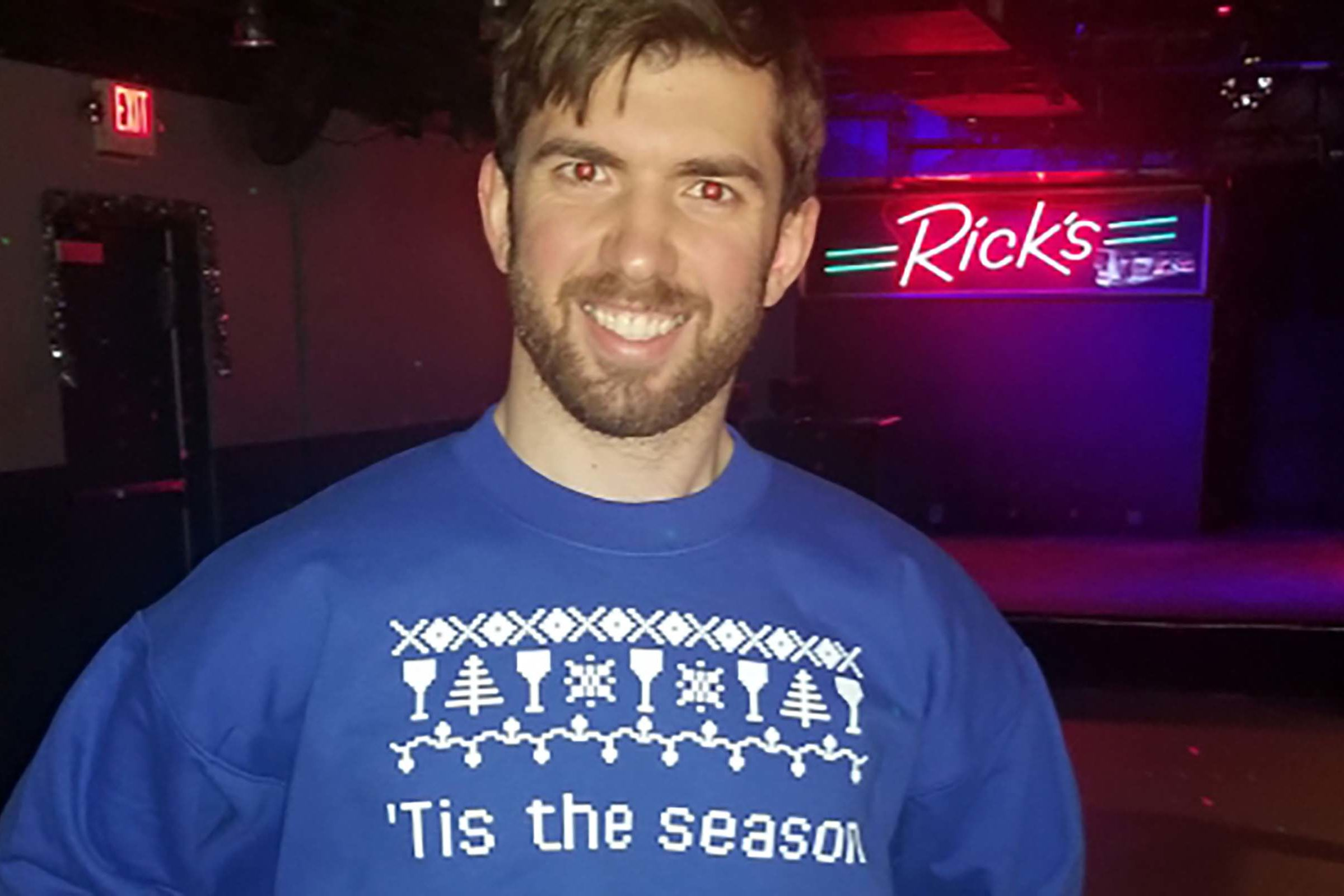 "Sam June in sweater that says ""Tis the season to go straight to Rick's"""