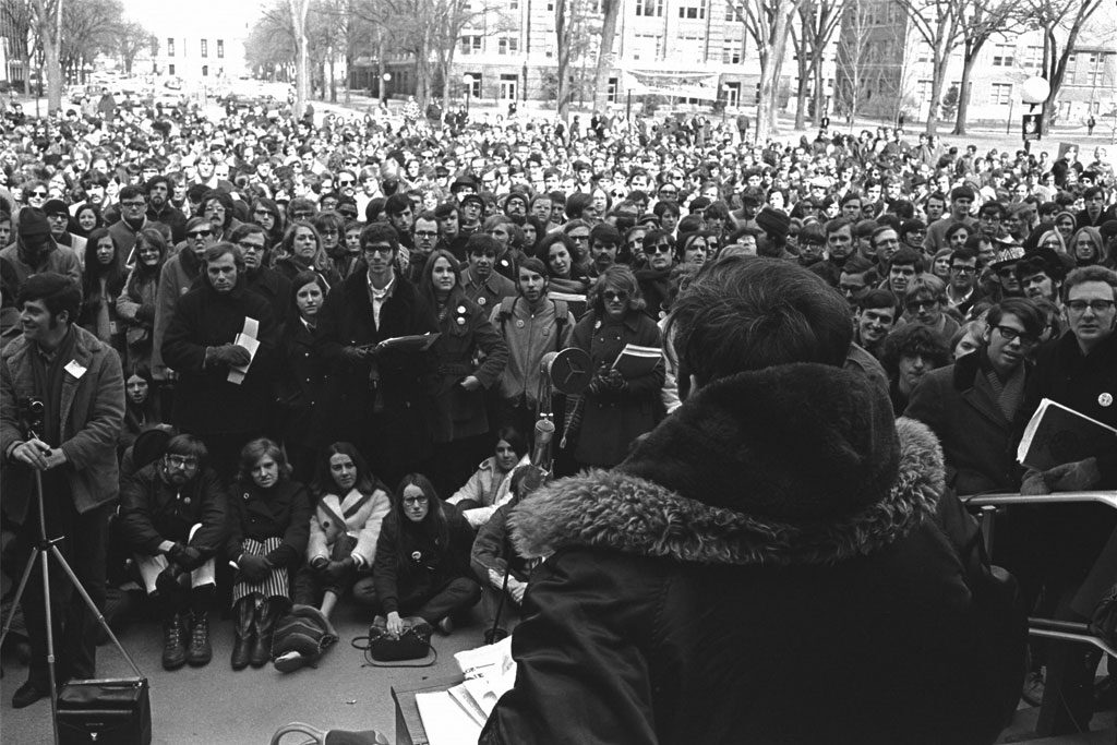 man speaking to a crowd