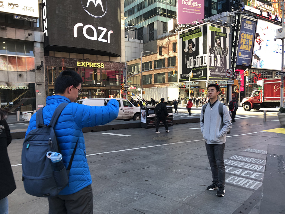 Students take photos in Times Square