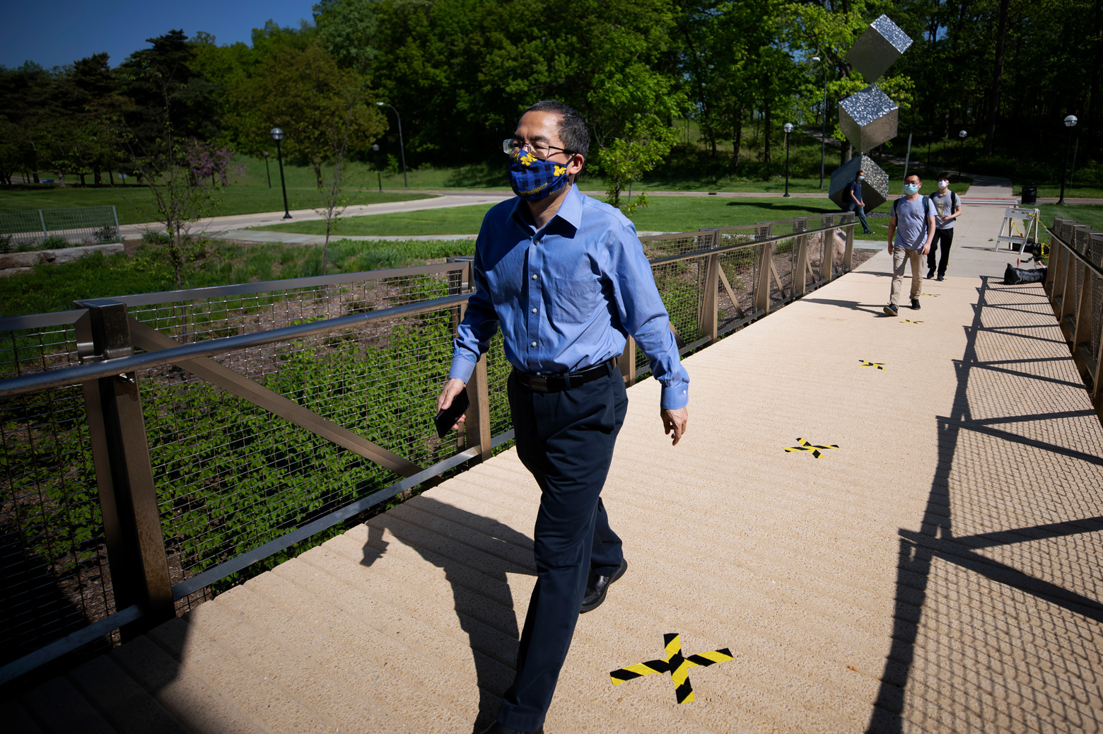 Zetian Mi, EECS Professor, walks into the G.G. Brown Building on North Campus of the University of Michigan in Ann Arbor, MI on May 26, 2020.