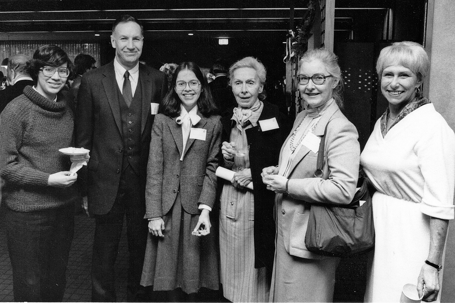 Susan with family and others at UG Reception in 1984
