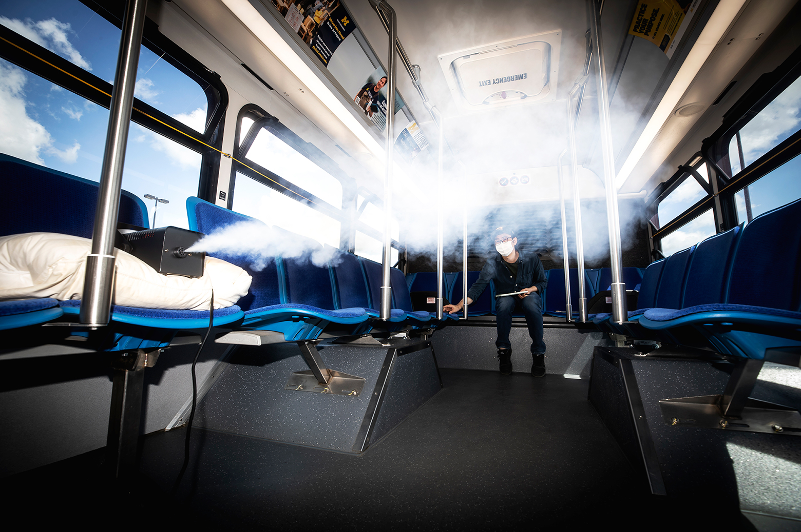 Kwang Hee Yoo, ME Researcher, measures the flow of aerosols in a University of Michigan blue bus in Ann Arbor, MI on June 24, 2020. Photo: Joseph Xu/Michigan Engineering, Communications & Marketing