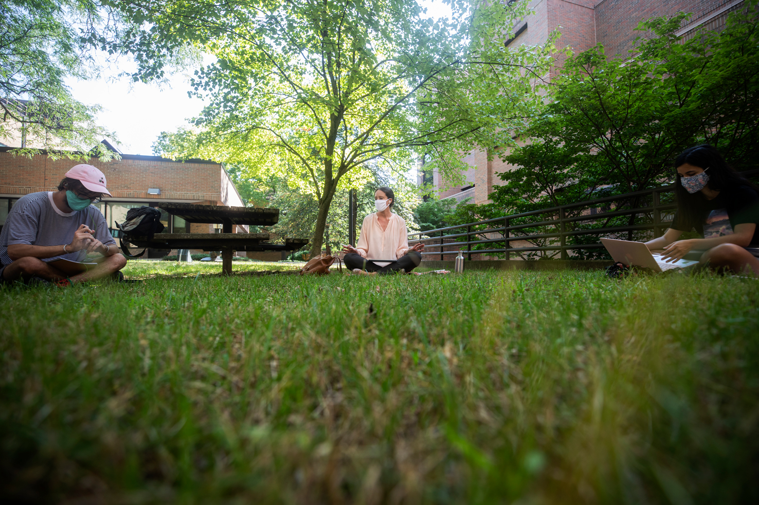 Lissa MacVean, a lecturer in civil and environmental engineering, teaches her graduate course outside. Photo by Joseph Xu