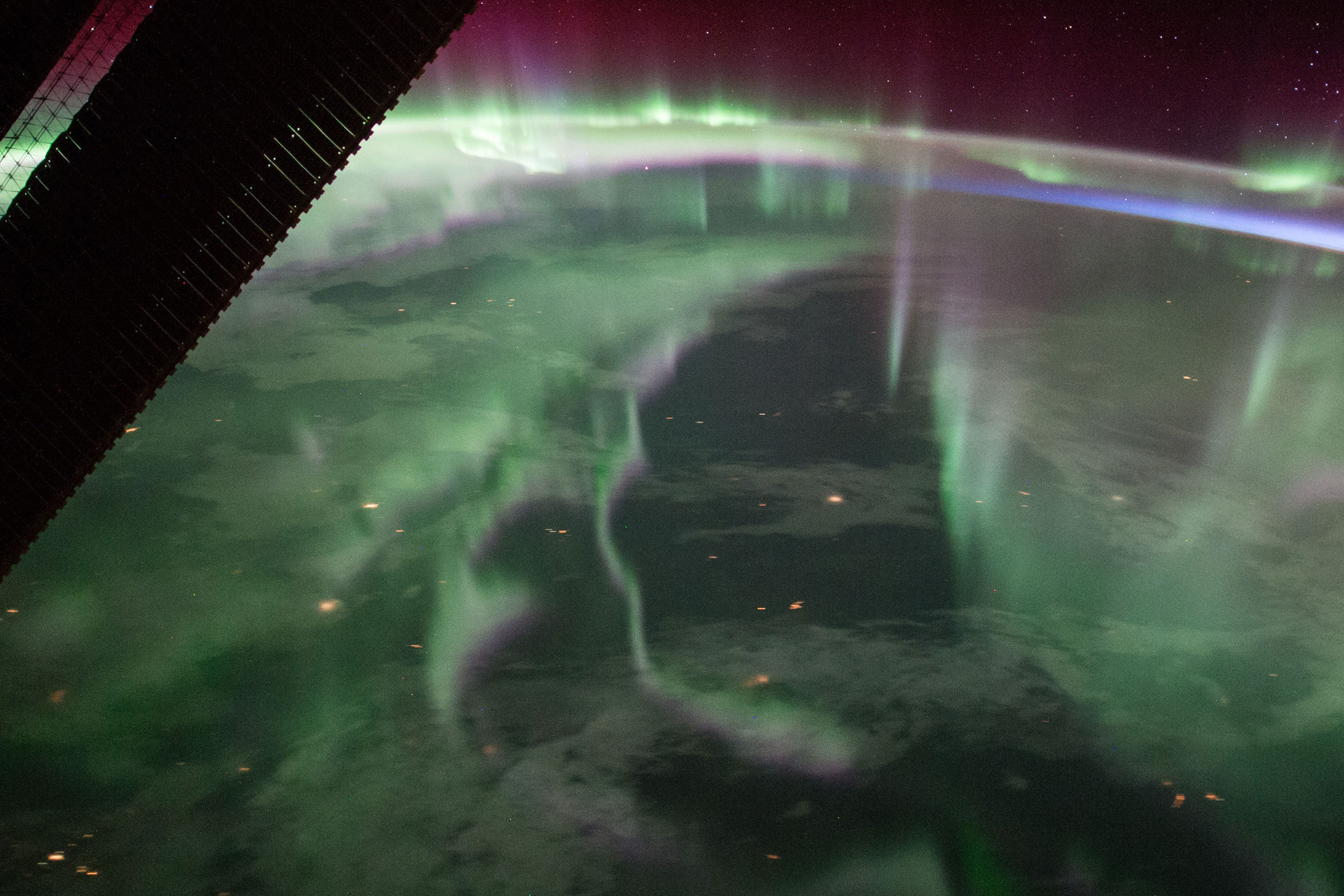 the ISS overlooks aurora borealis