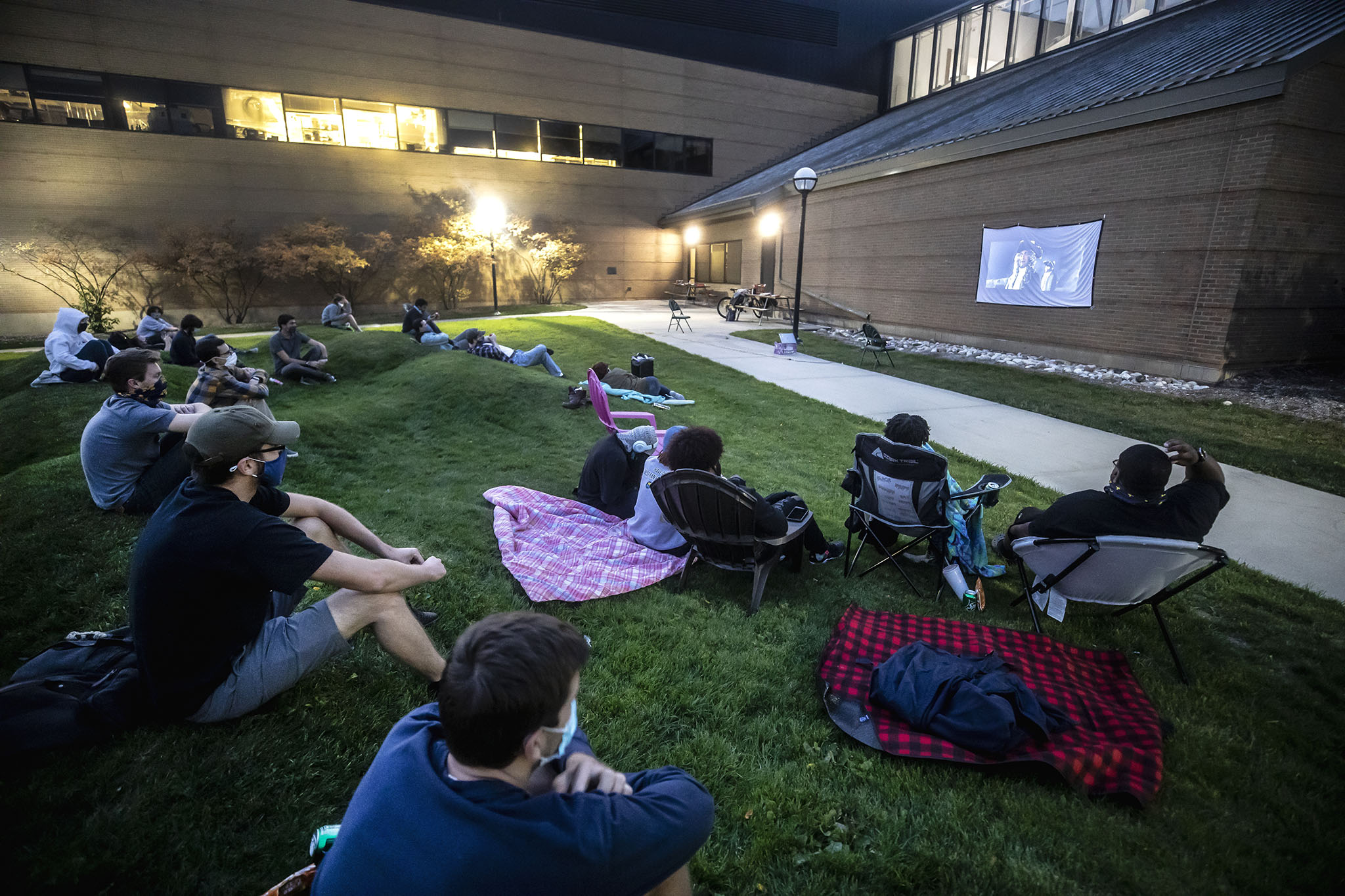 A photo of students watching a movie on the wave field of North Campus.