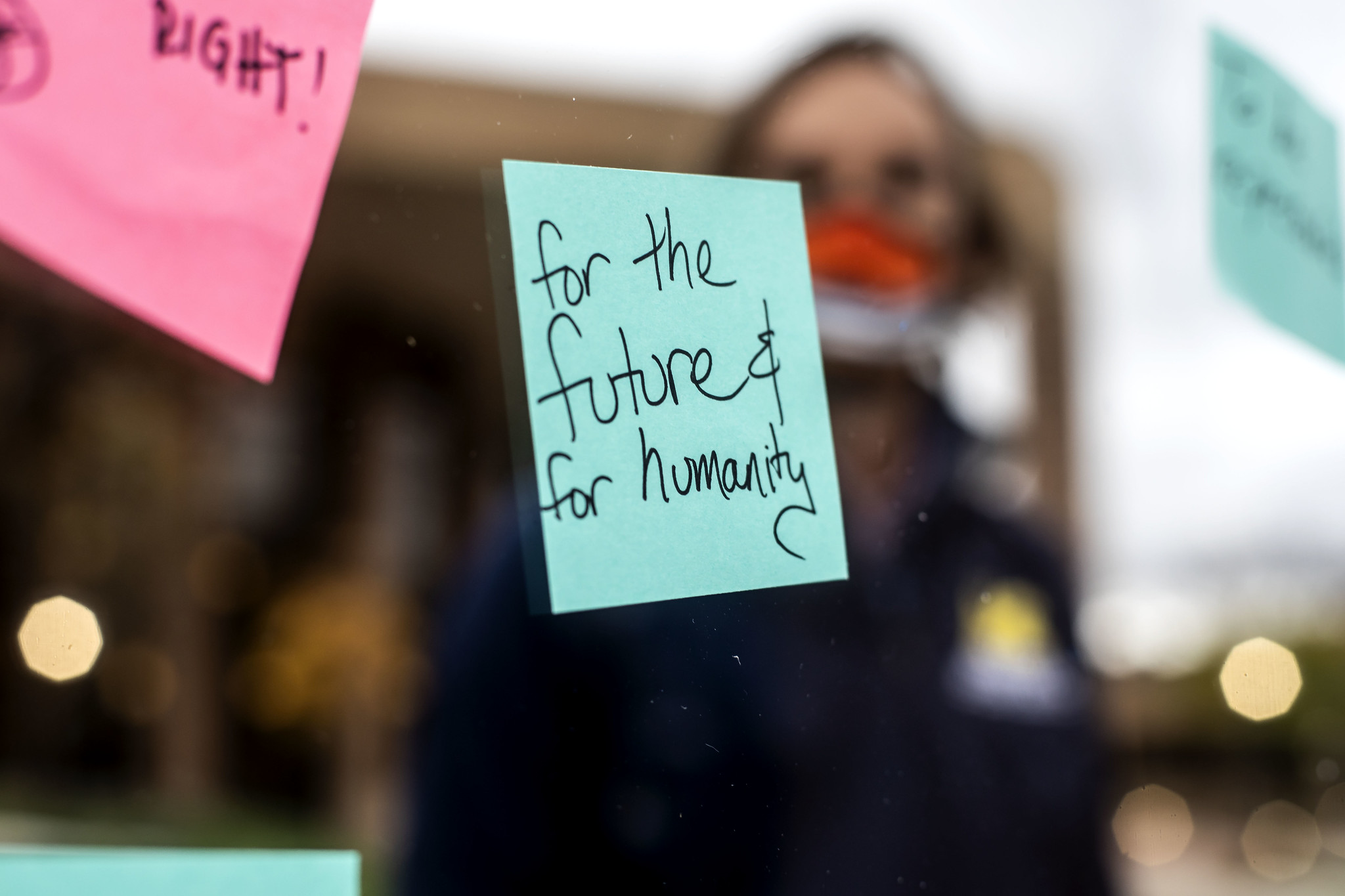 "post-it note on a window reads ""for the future and for humanity"""