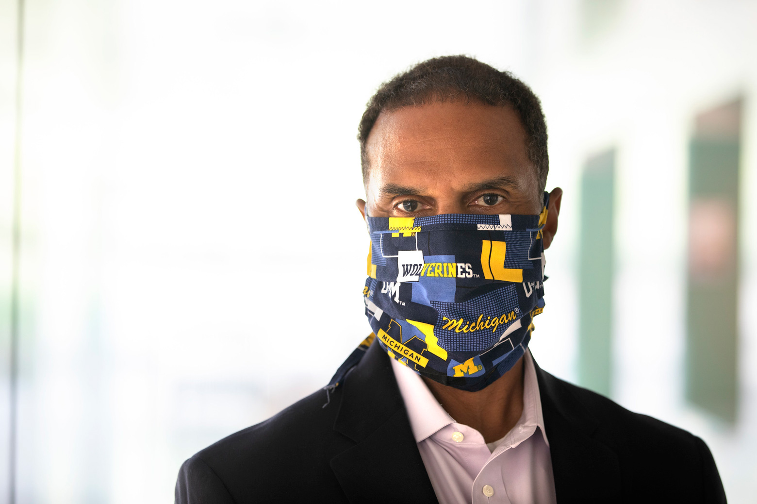 Dean Gallimore spots a mask on campus posing for a portrait. Wednesday, August 26, 2020.