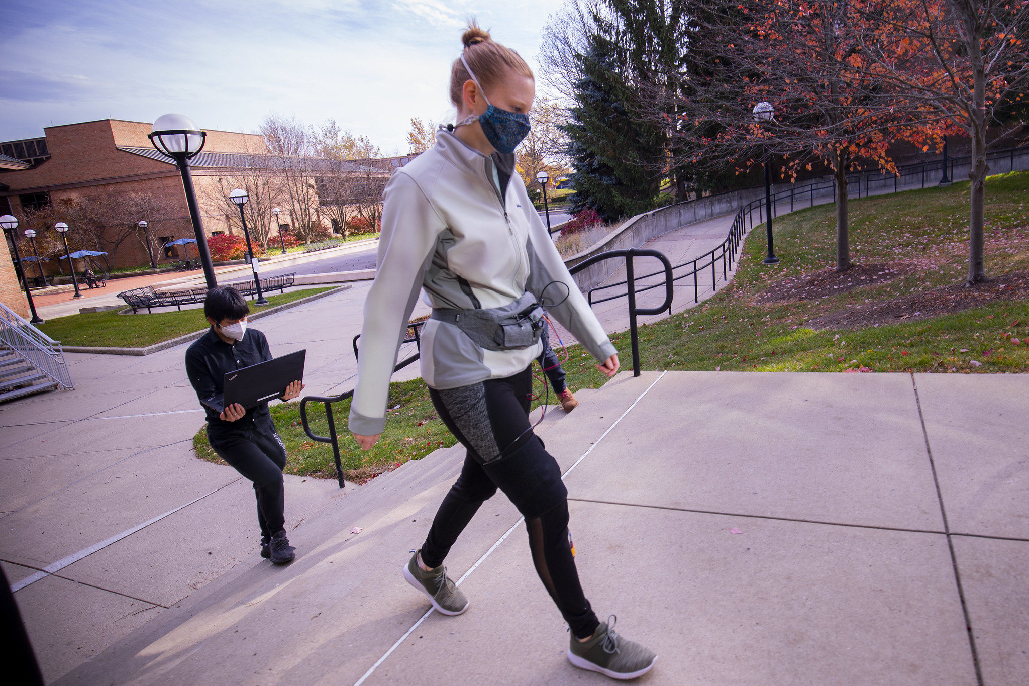 A photograph of a researcher walking and testing a sensor.