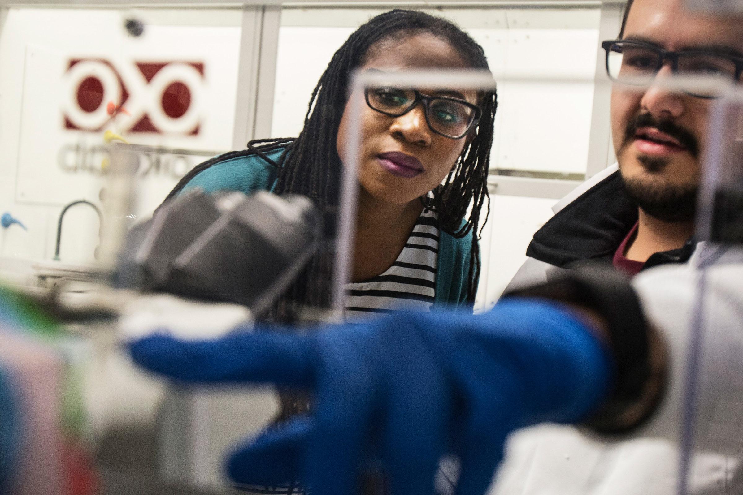 Mario Gutierrez consults Prof. Lola Eniola in a lab