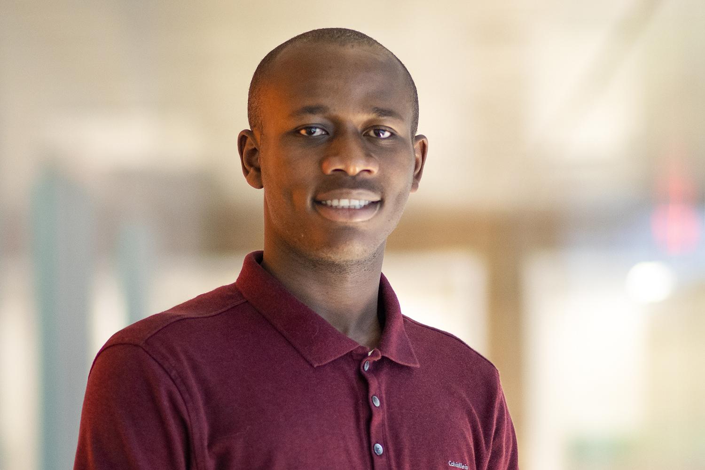 Demba Komma headshot
