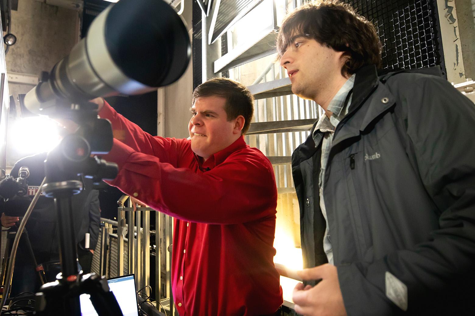 Researchers assembling telescope