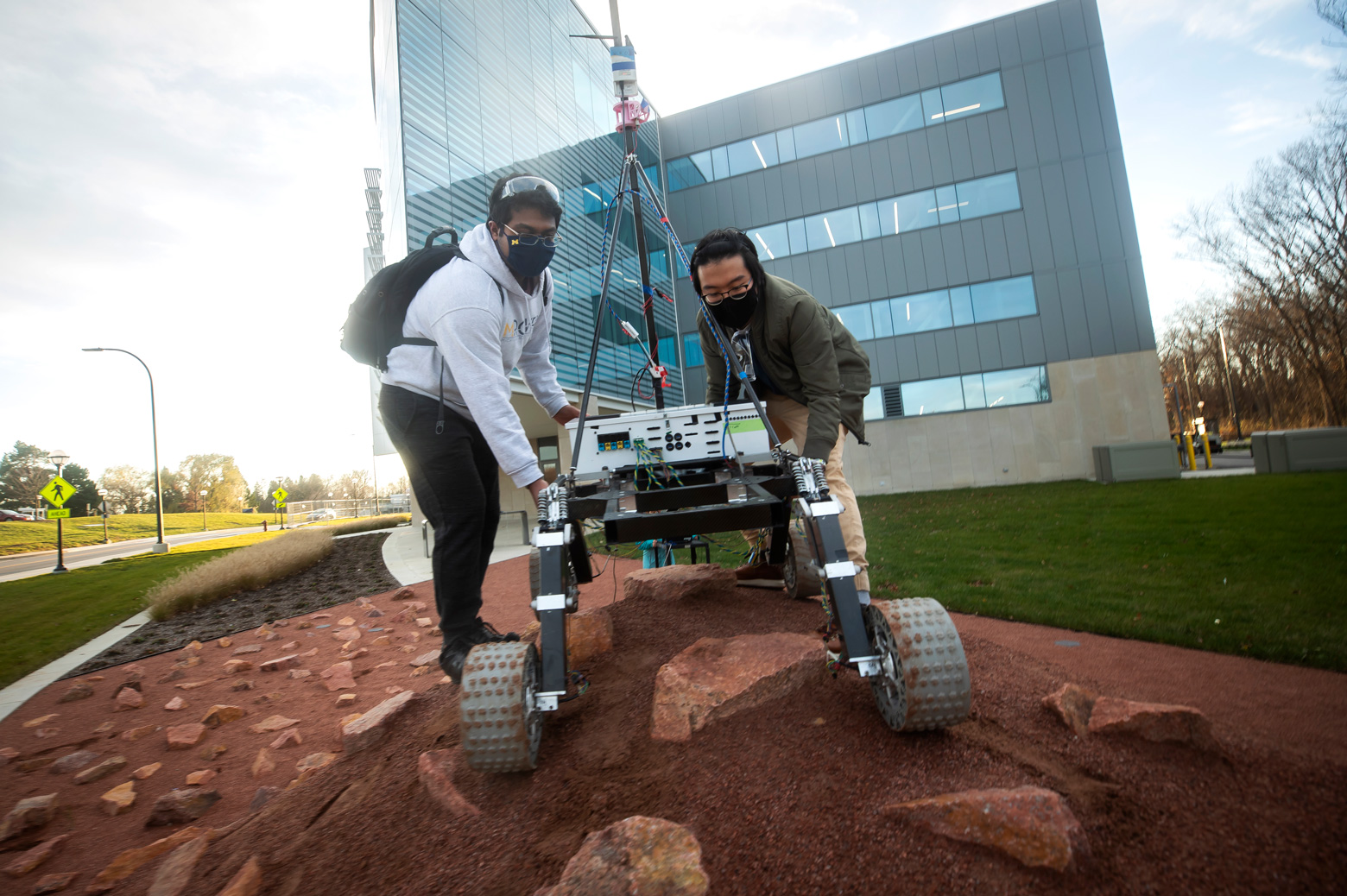 The Michigan Mars Rover team tests their Mars Rover on the Mars Yard outside of the Ford Robotics Building.