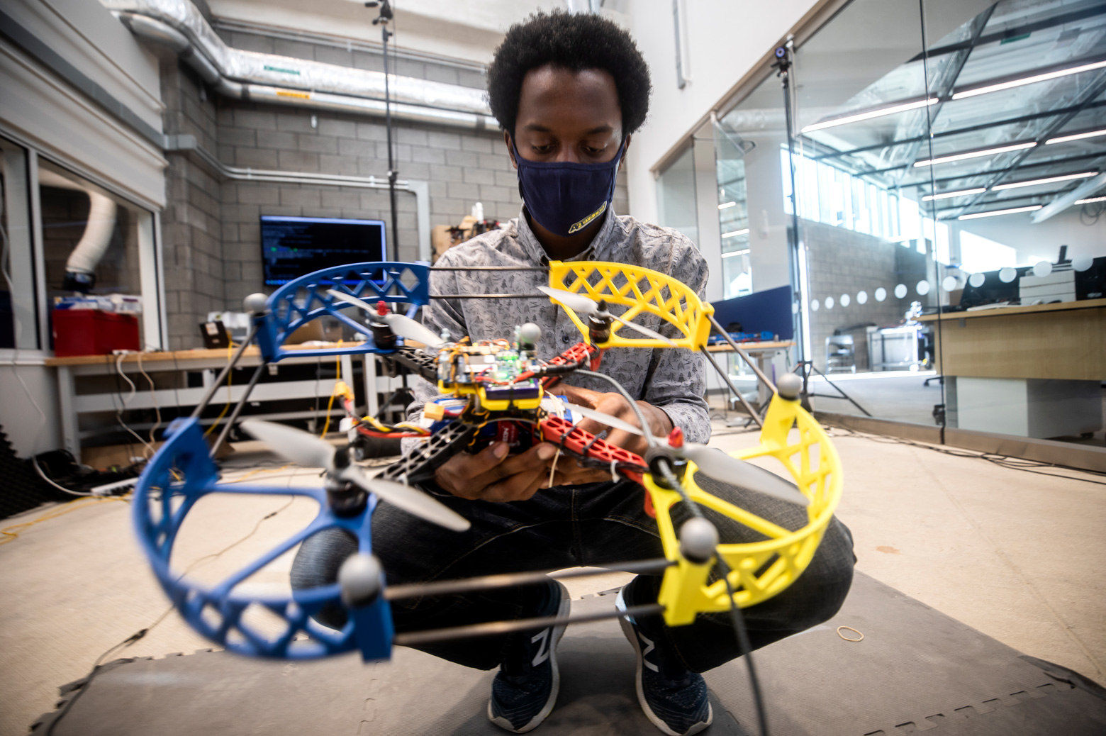 Prince Kuevor, Robotics PhD Student, changes a battery on a drone in the Fly Lab in the Ford Robotics Building at the University of Michigan in Ann Arbor, MI.