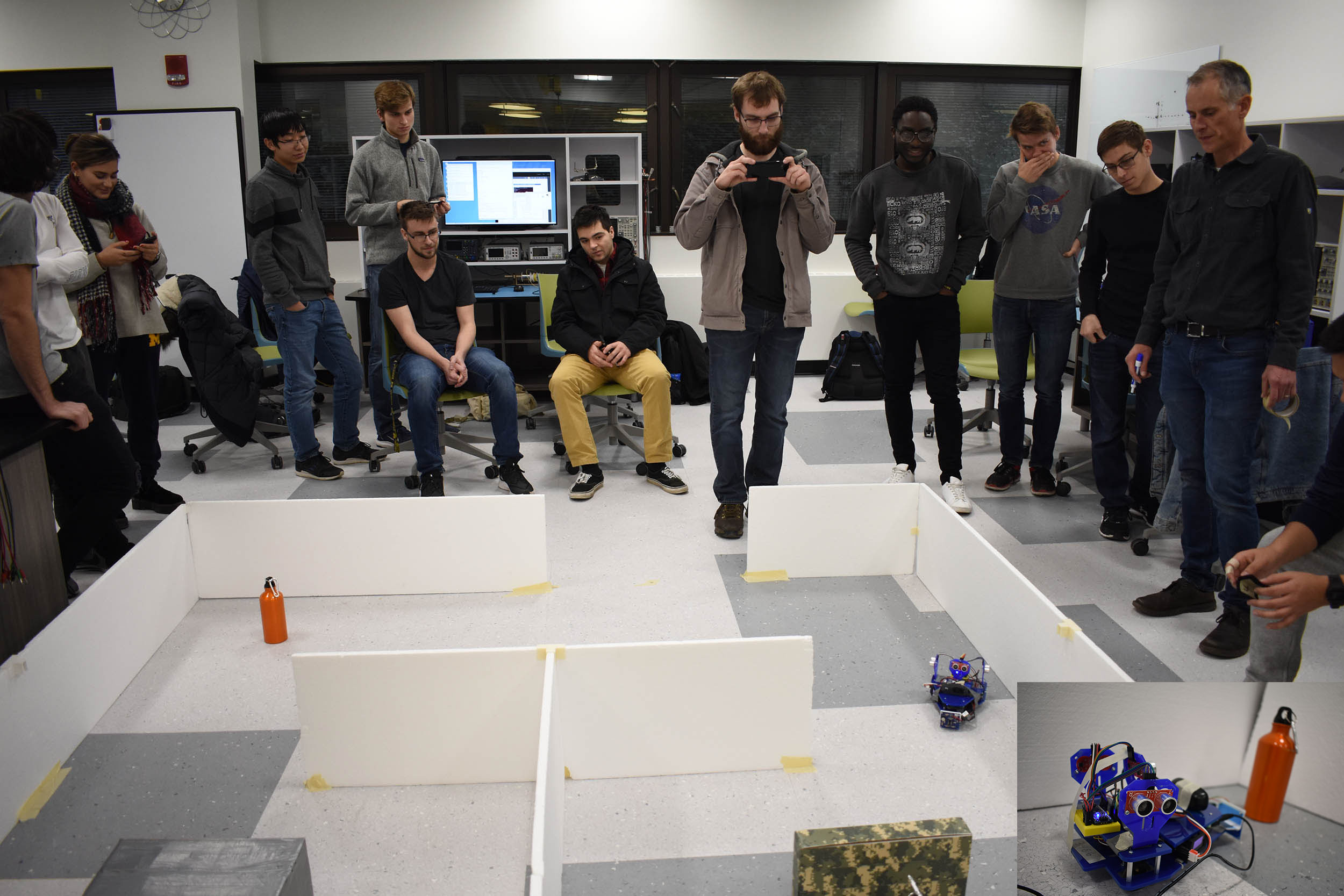students watching the robot in a maze