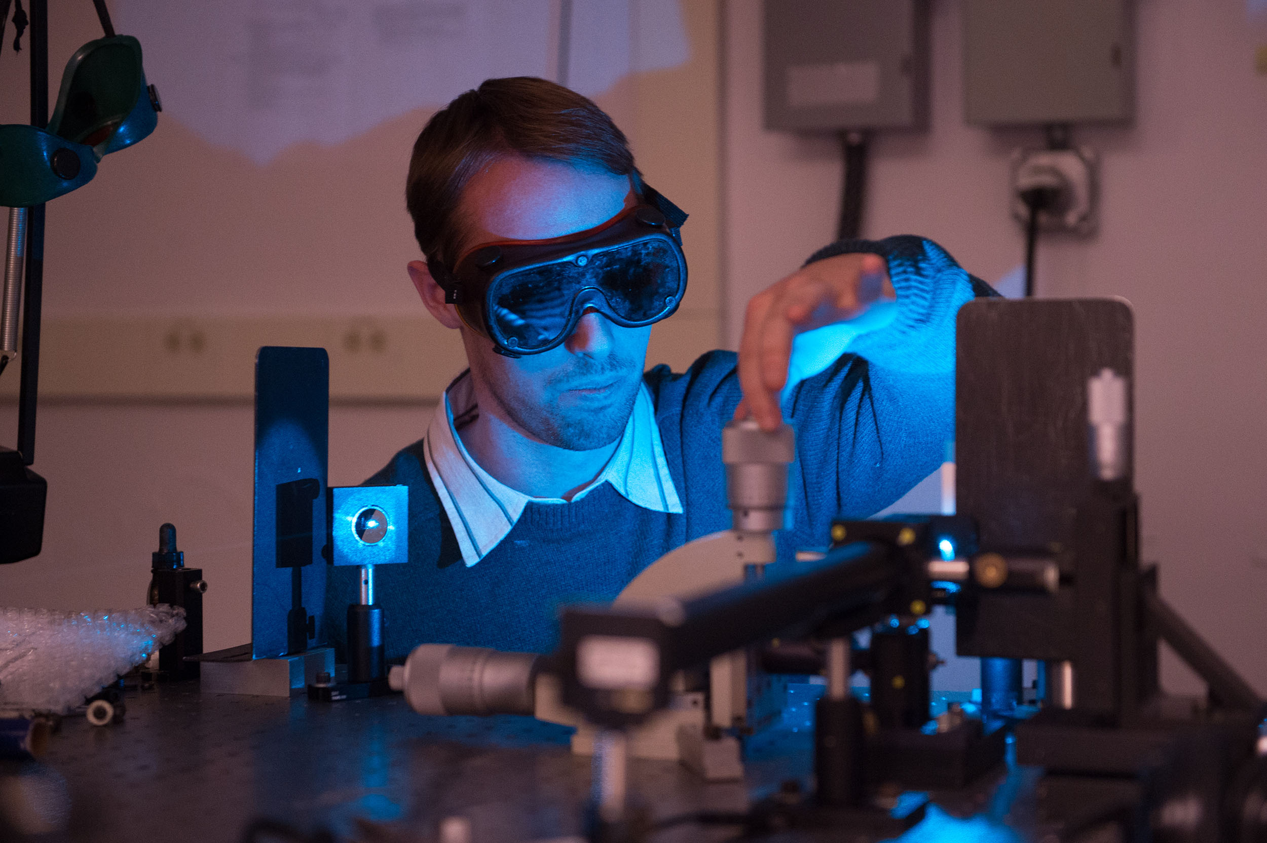 student in a laser lab