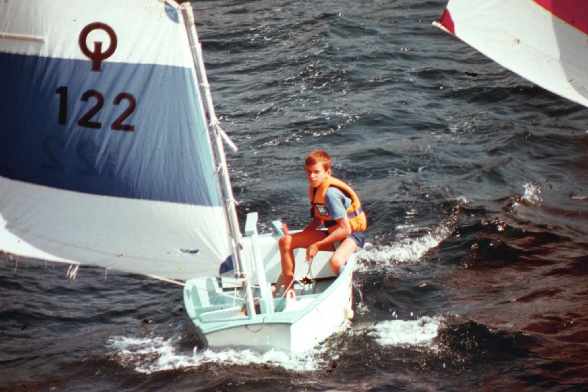 Teenage boy in sailboat