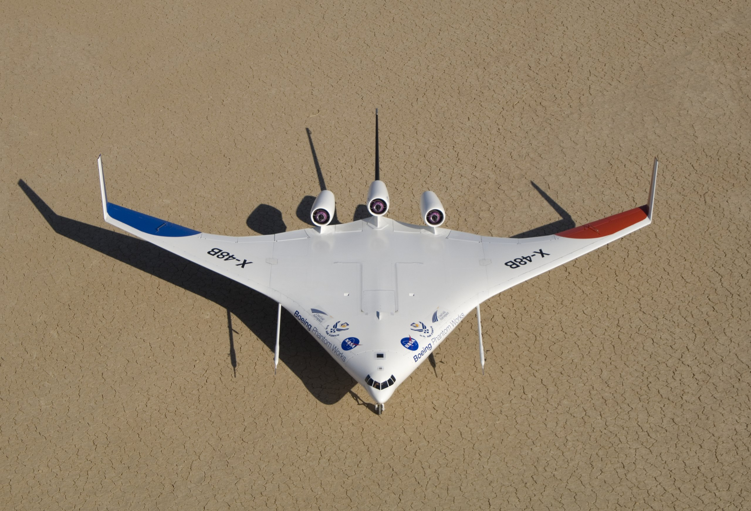 Boeing's colorful X-48B Blended Wing Body technology demonstrator shows off its unique triangular lines while parked on Rogers Dry Lake adjacent to NASA Dryden.