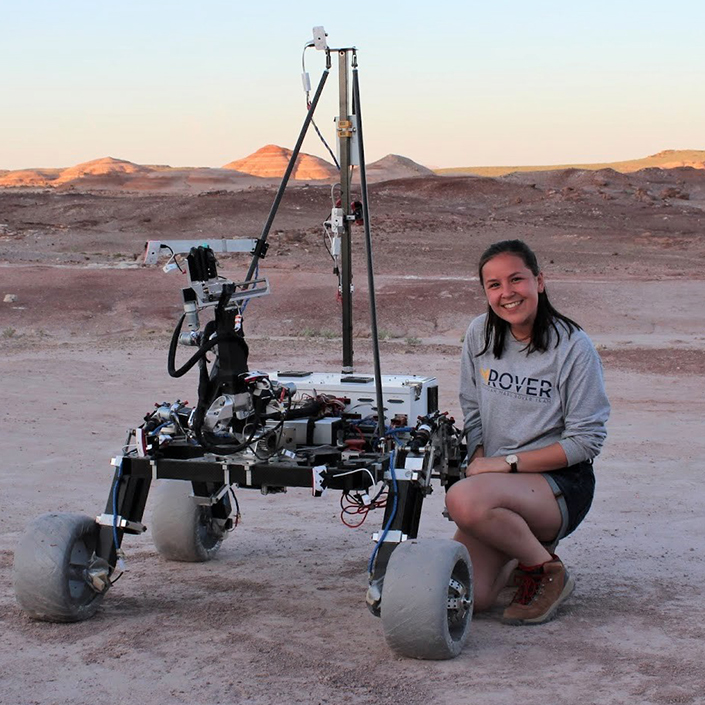 Michelle Gehner next to the Michigan Mars Rover