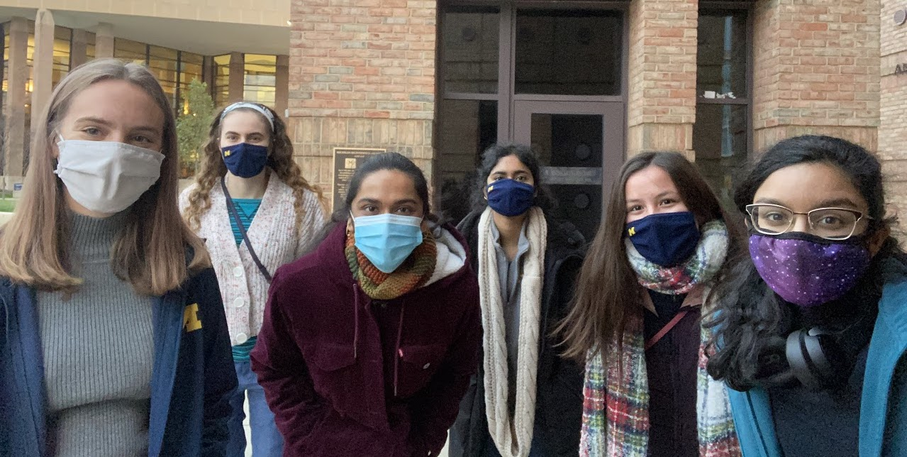 Group of women from WECE on campus with masks