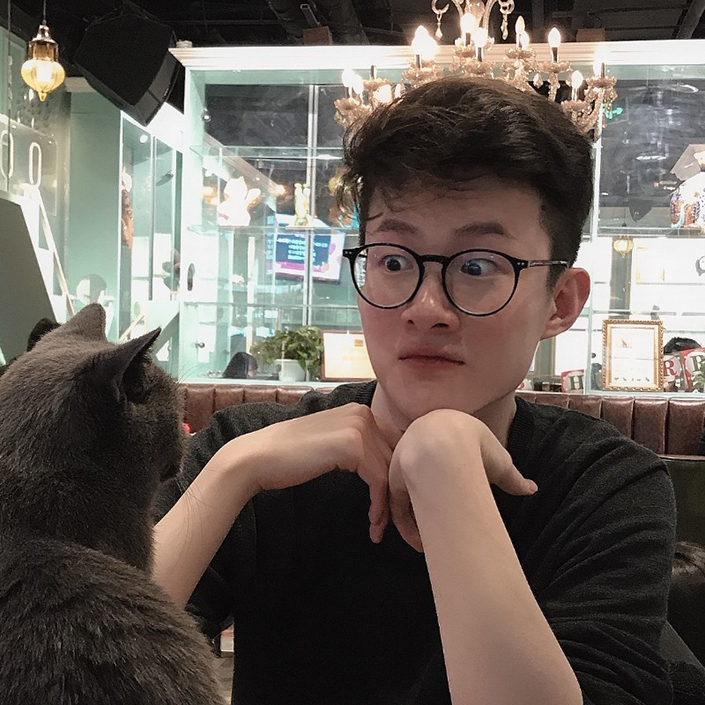 Sky Wang has a staring contest with a grey cat, who is clearly winning