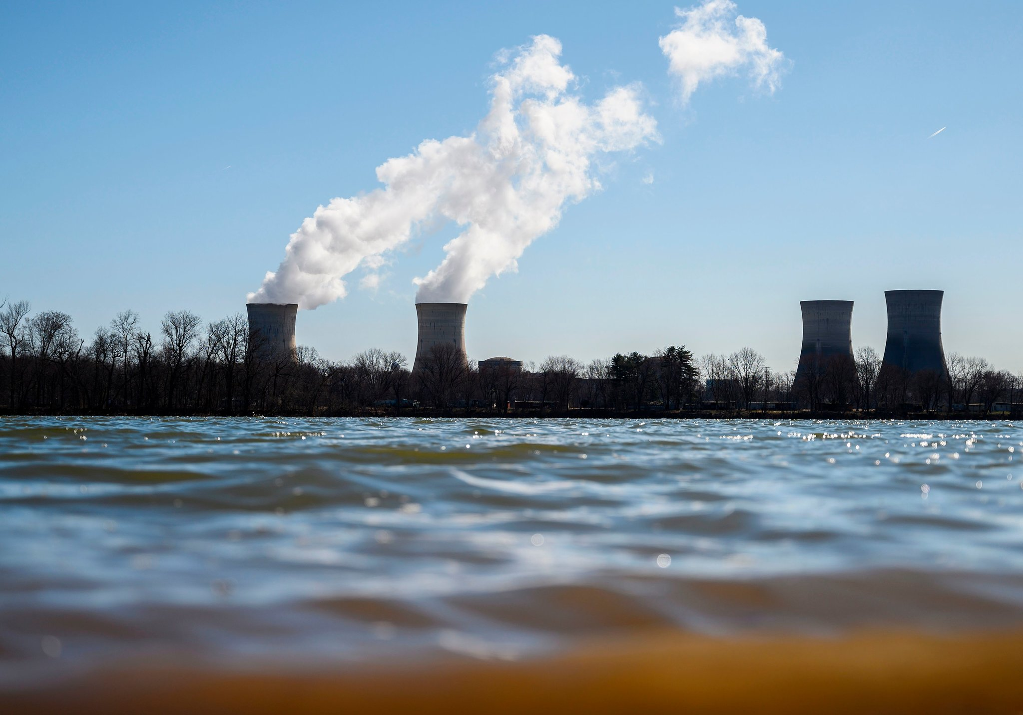 nuclear power plants in front of a lake