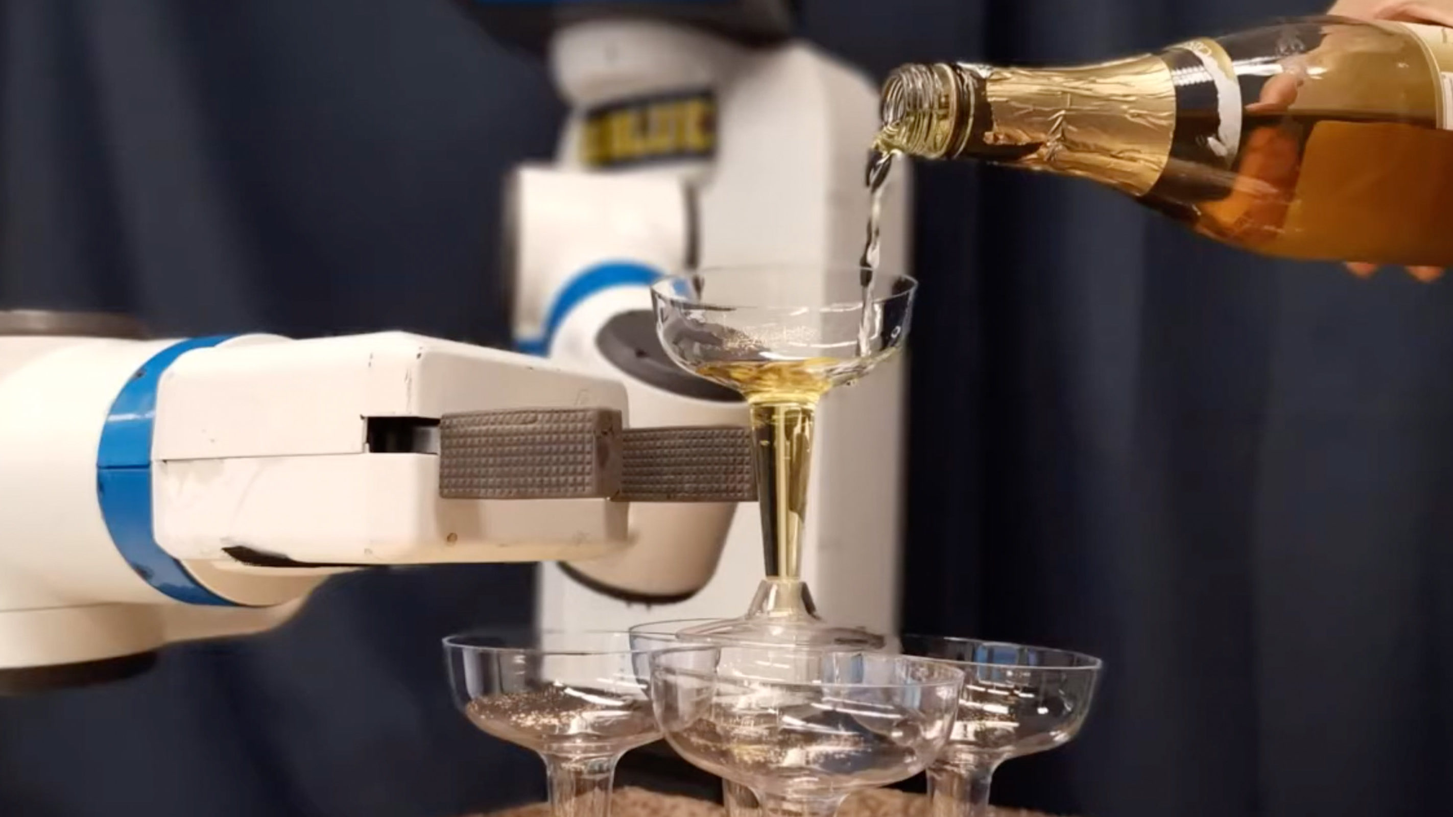 Robot building a tower of champagne glasses